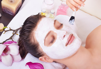 Beauty woman getting facial mask