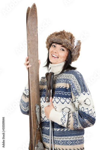 smiling woman in winter clothes with old wooden skis