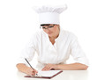 female chef writing on clipboard
