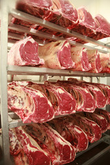 Cuts of beef on shelves in an abattoir