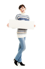 young winter woman with empty sign