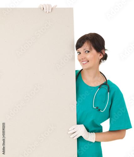 female doctor keeping  blank billboard
