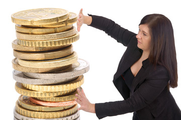 Business woman with a stack of euro coins
