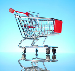 Shopping Cart Isolated On Blue