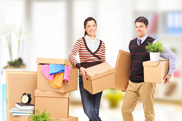 A young man and woman moving into an apartment