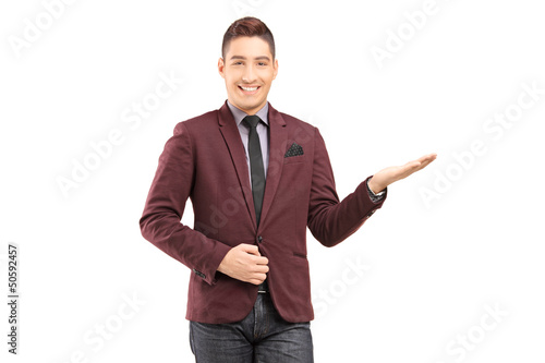 A stylish smiling male gesturing with his hand