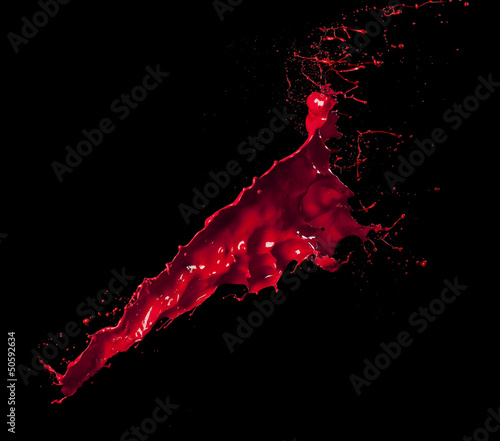 splashes of red paint isolated on black background