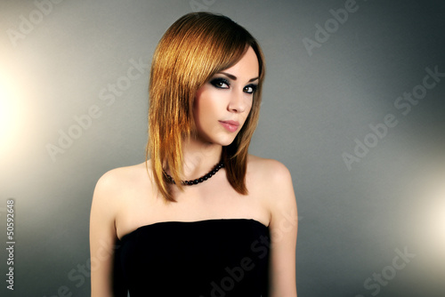Sensual girl with straight hair and beautiful makeup