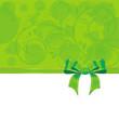 Hintergrund aus Ornamenten und einer Schleife in grün