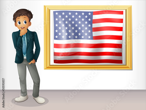 A framed flag of the USA beside a man