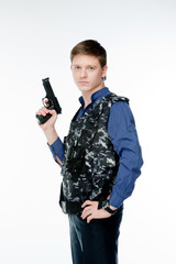 young and handsome man with a gun in his hand