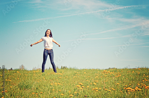 young happy smiling woman in nature