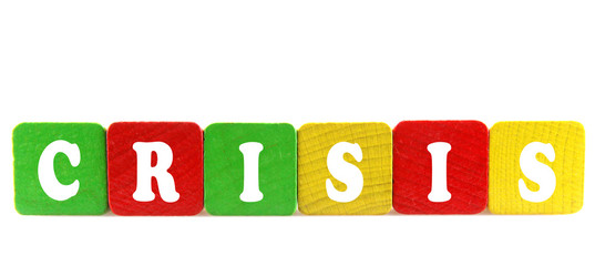 crisis - isolated text in wooden building blocks