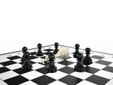 white chess king lies surrounded by black chess pawns