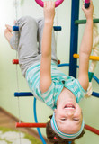 little girl at gymnastic rings
