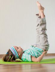 little girl doing gymnastic exercises