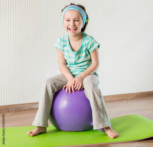 little girl doing gymnastic exercises