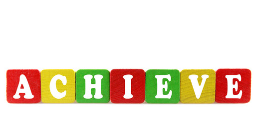 achieve - isolated text in wooden building blocks