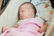 newborn in pram