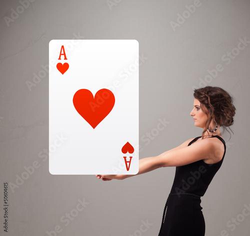 Beautifu woman holding a red heart ace