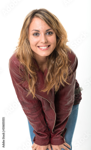 Smiling girl in leather jacket