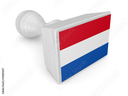 Wooden stamp with dutch flag.