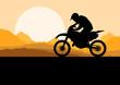 Motorbike rider motorcycle silhouette in wild desert mountain