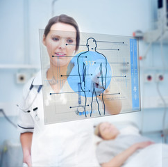 Nurse touching screen displaying blue human form