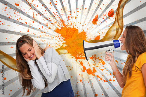 Girl shouting at her friend through a megaphone