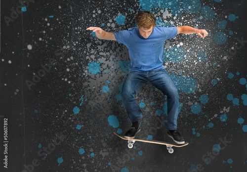 Cool young skateboarder doing an ollie trick