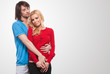 couple in love. Isolated over grey background.