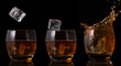 Serial arrangement of ice falling into whiskey glass
