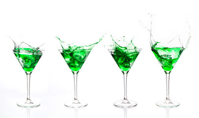 Serial arrangement of green liquid splashing in cocktail glass