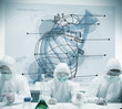 Chemists working with futuristic interface showing heart and DNA