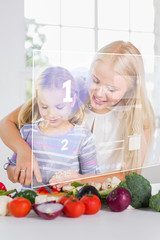 Mother and daughter chopping vegetables with holographic interfa