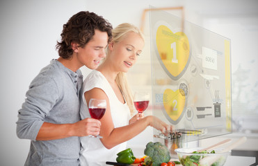 Couple making dinner using interface instructions