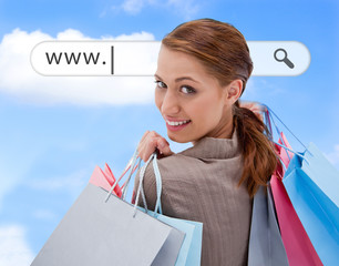 Woman looking over her shoulder with shopping bags