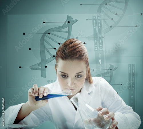 Blonde scientist working with futuristic interface and  pouring