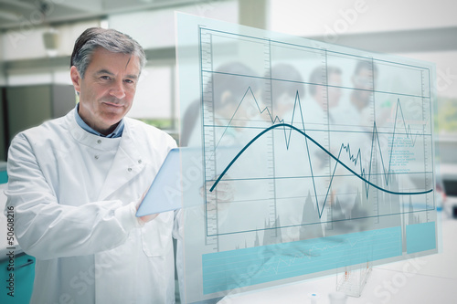 Confident scientist working with tablet and futuristic interface