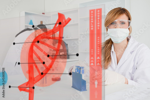 Chemist working in protective suit with futuristic interface in