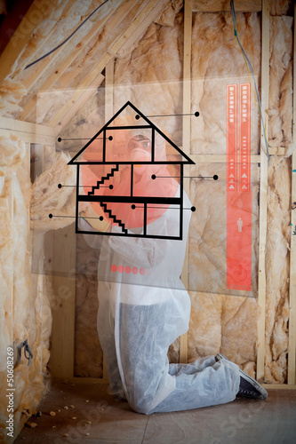Man insulating walls following instructions on interface
