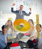 Cheerful business people using yellow pie chart interface