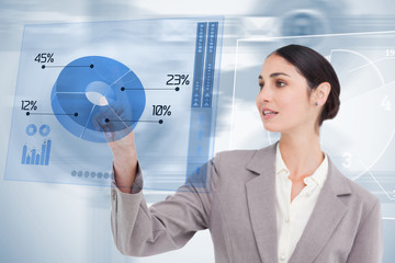 Businesswoman using colorful blue futuristic interface