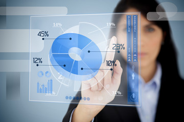 Serious businesswoman using blue pie chart interface