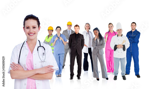 Smiling doctor in front of a team of different workers