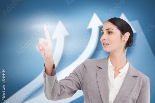 Businesswoman using transparent futuristic interface