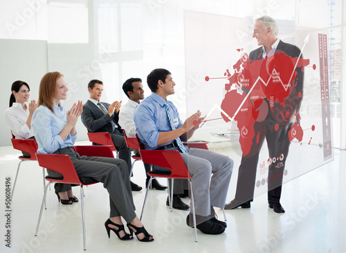 Business people clapping stakeholder standing in front of red ma