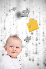 Jigsaw pieces floating around a baby