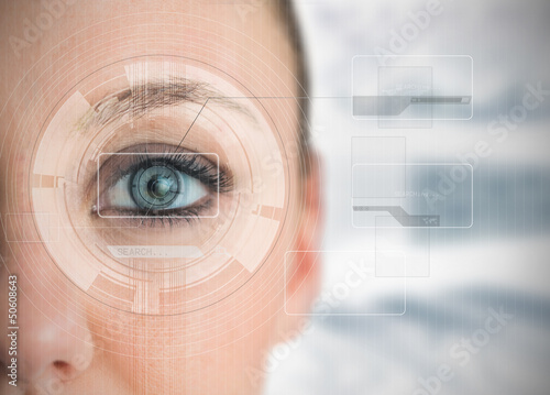 Close up of woman blue eye analyzing chart interfaces