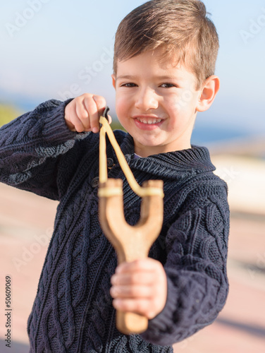 Boy Aiming With A Slingshot
